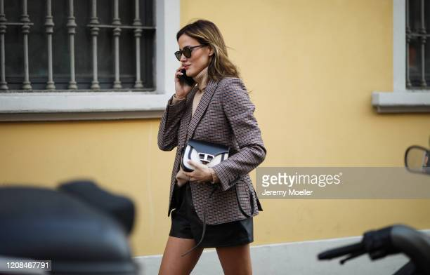 Fashion Week guest is seen before Tods during Milan Fashion Week Fall/Winter 2020-2021 on February 21, 2020 in Milan, Italy.