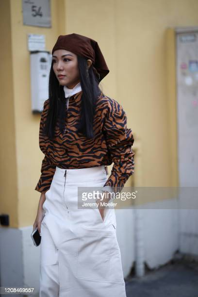 Fashion Week guest is seen wearing a animal print sweater and midi white skirt before Tods during Milan Fashion Week Fall/Winter 2020-2021 on...