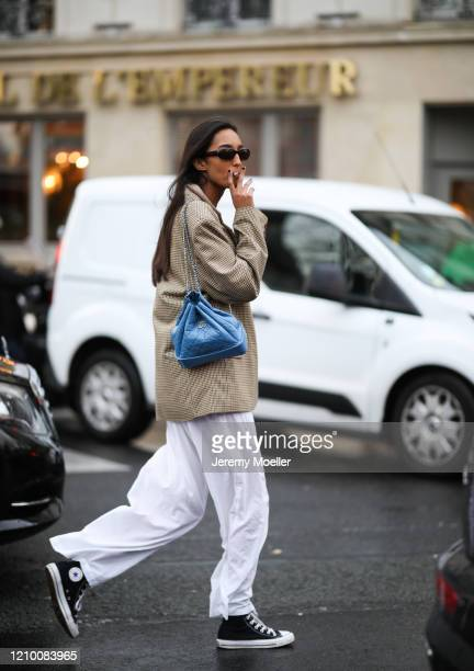 Fashion Week guest is seen wearing a blue Chanel bag outside Valentino show during Paris Fashion week Womenswear Fall/Winter 2020/2021 Day Seven on...