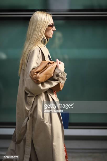 Fashion Week guest is seen wearing a Bottega Veneta pouch before Emporio Armani during Milan Fashion Week Fall/Winter 2020-2021 on February 21, 2020...