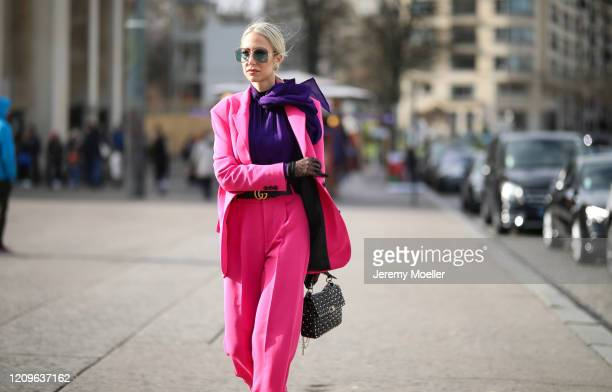 Fashion Week guest is seen wearing a pink suit and Maison Valentino bag outside Haider Ackermann show during Paris Fashion week Womenswear...