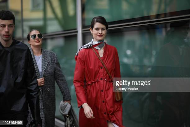 Fashion Week guest is seen wearing a red dress before Emporio Armani during Milan Fashion Week Fall/Winter 2020-2021 on February 21, 2020 in Milan,...