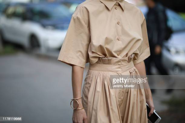 Fashion Week guest on September 28, 2019 in Paris, France.