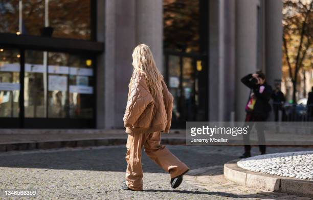 Fashion Week Guest wearing a brown jacket and brown pants outside Miu Miu Show on October 05, 2021 in Paris, France.