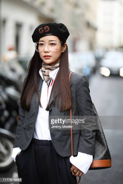 Fashion Week guest wearing a Celine nackpack and Gucci hat on September 29, 2019 in Paris, France.