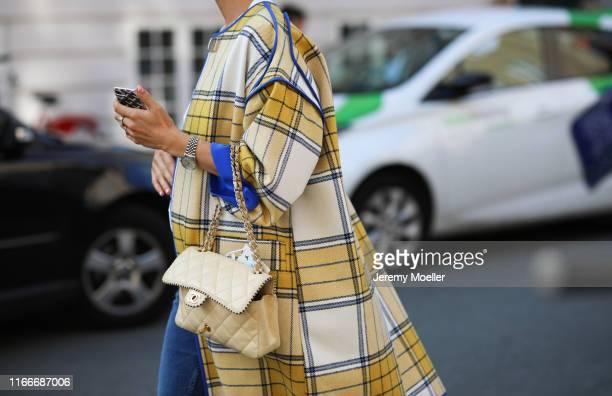 Fashion Week guest wearing a Chanel bag on August 07, 2019 in Copenhagen, Denmark.