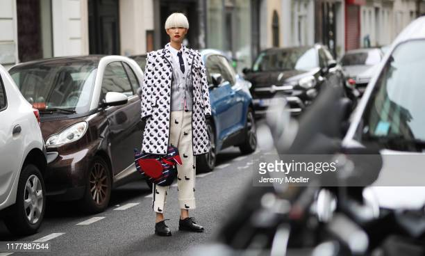 Fashion Week guest wearing a complete Thom Browne outfit on September 29, 2019 in Paris, France.