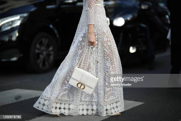 Fashion Week guest wearing a DIor dress and bag on January 20, 2020 in Paris, France.