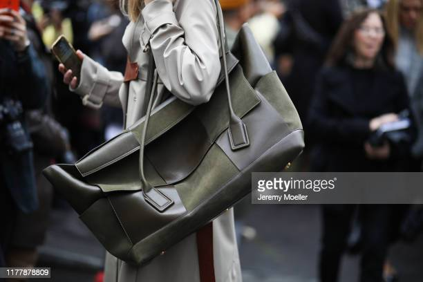 Fashion Week guest wearing a maxi Bottega Veneta bag on September 29 2019 in Paris France