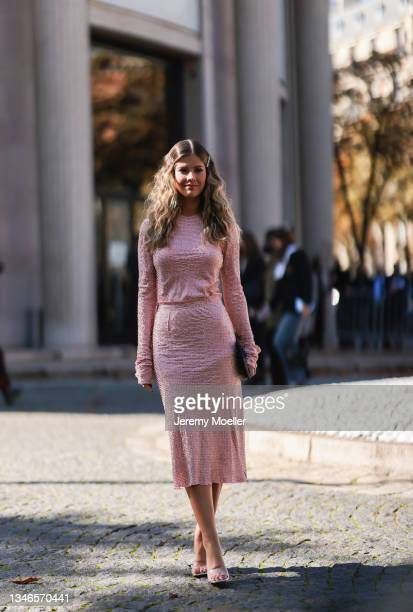 Fashion Week Guest wearing a rose dress outside Miu Miu Show on October 05, 2021 in Paris, France.