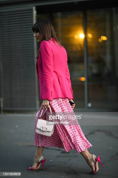 Fashion Week guest wearing a Valentino bag before Ralph & Russo on January 20, 2020 in Paris, France.