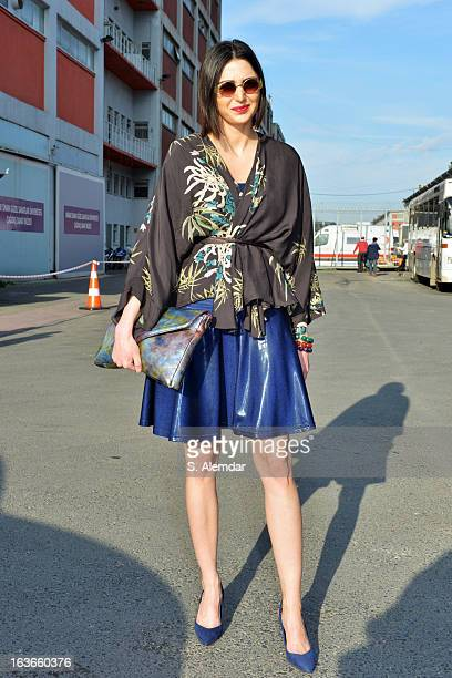 Fashion week guest wearing American Apparel dress, H&M bag and Zara coat is seen during Mercedes-Benz Fashion Week Istanbul Fall/Winter 2013/14 at...
