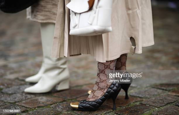 Fashion Week guest wearing Gucci socks and Bottega Veneta bag and heels before Mykke Hofmann on January 28, 2020 in Copenhagen, Denmark.
