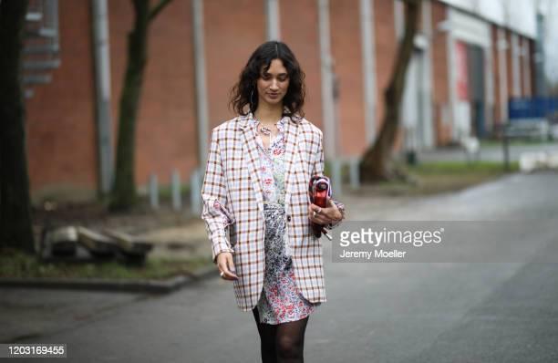 Fashion Week guest wearing Lala Berlin blazer and dress before LalaBerlin on January 30 2020 in Copenhagen Denmark