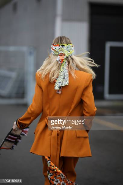 Fashion Week guest wearing Lala Berlin suit and bag before LalaBerlin on January 30, 2020 in Copenhagen, Denmark.
