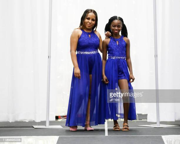 FTM Fashion Week owner Latasha Baggs and model walk the runway at the FTM Fashion Week S7 at Sturgeon City on November 23 2019 in Jacksonville North...