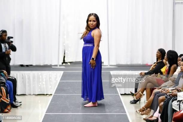 Fashion Week owner Latasha Baggs walks the runway at the FTM Fashion Week S7 at Sturgeon City on November 23 2019 in Jacksonville North Carolina