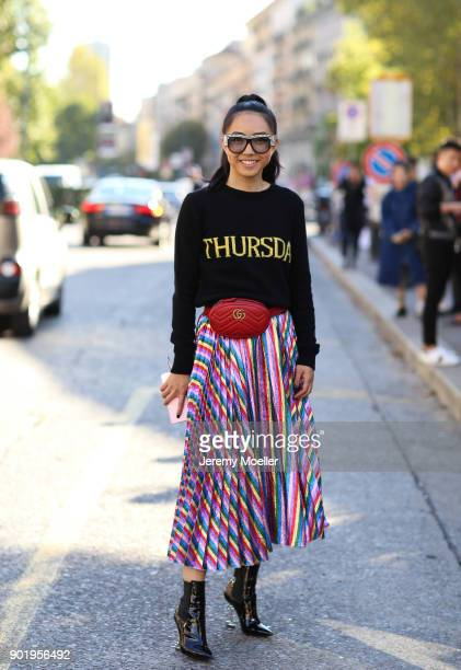 Fashion Week visitor wearing a Gucci belt bag sunglasses Alberta Ferretti hoodie on September 20 2017 in Milan