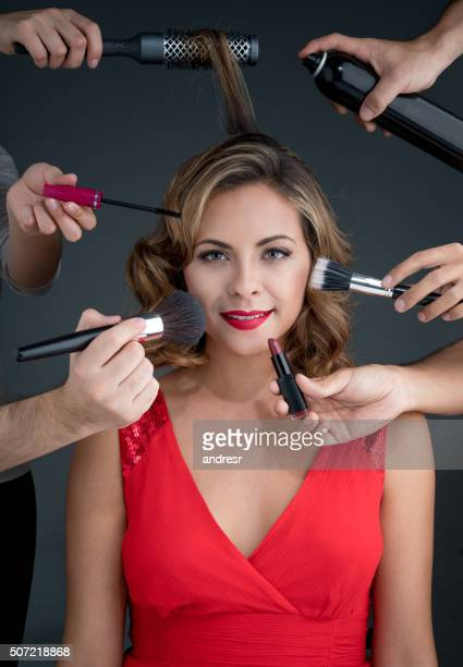 Fashion woman getting her makeup done