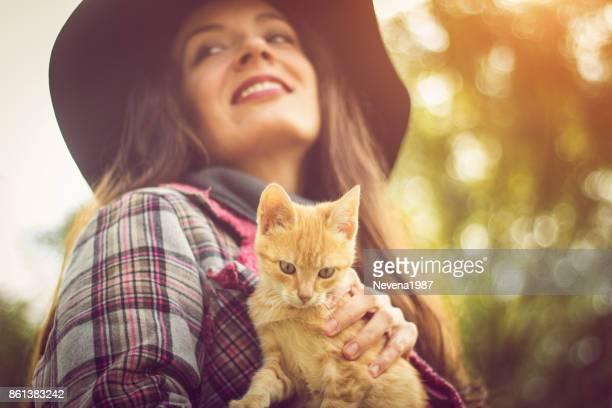 Fashion woman holding yellow cat