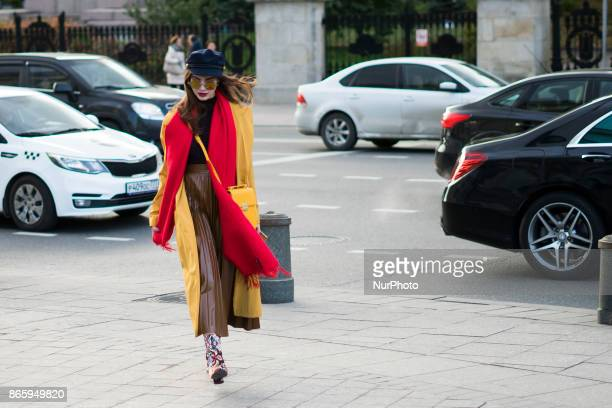 Fashion woman walks in the street of Moscow duiring Mercedes Benz Fashion Week Russia S/S 2018 on October 22 2017 in Moscow Russia