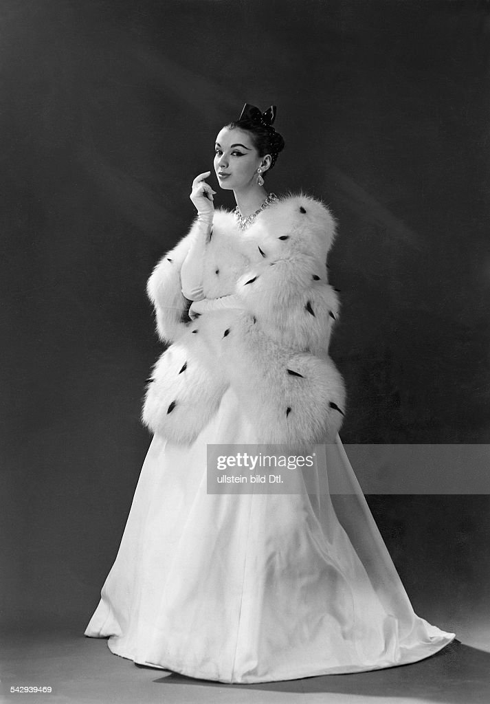 Fashion. Woman wearing an ermine cape and an evening gown by Jeanne ...