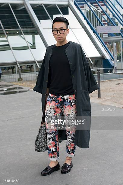 Fashion Writer Alan Jiang wears WeeJuns shoes Skotch Maison trousers Week day sweater Gogard bag and a Mathew Ames jacket on day 3 of Paris...