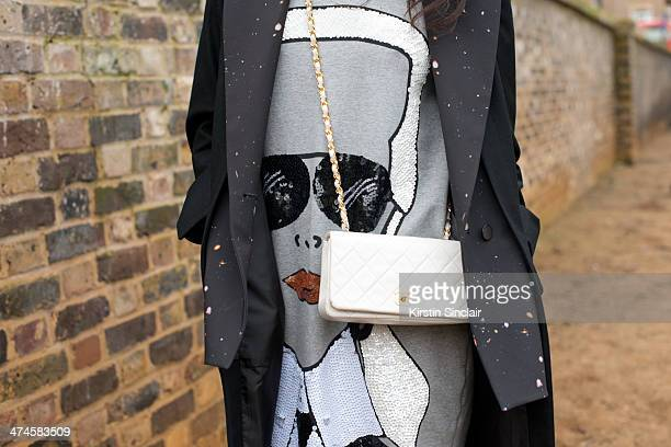Fashion writer Amy Marietta wears a Chanel bag Mua Mua Dolls top Cres e Dim Coat on day 4 of London Collections Women on February 17 2014 in London...