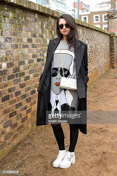 Fashion writer Amy Marietta wears a Chanel bag Mua Mua Dolls top Solestruck shoes Cres e Dim Coat and Tom Ford sunglasses on day 4 of London...