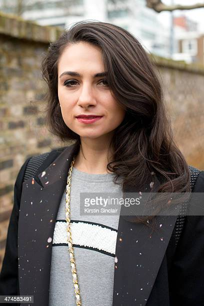 Fashion writer Amy Marietta wears a Mua Mua Dolls top Cres e Dim Coat on day 4 of London Collections Women on February 17 2014 in London England