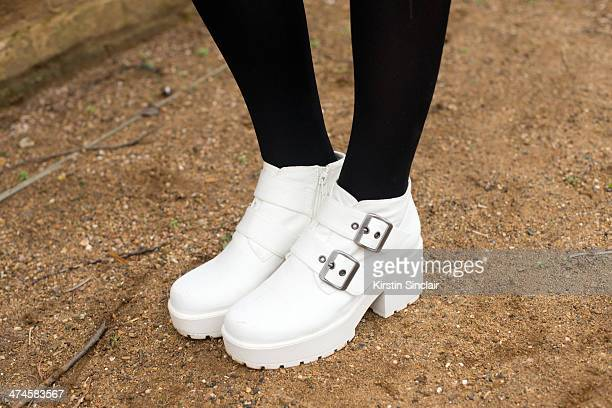 Fashion writer Amy Marietta wears Solestruck shoes on day 4 of London Collections Women on February 17 2014 in London England