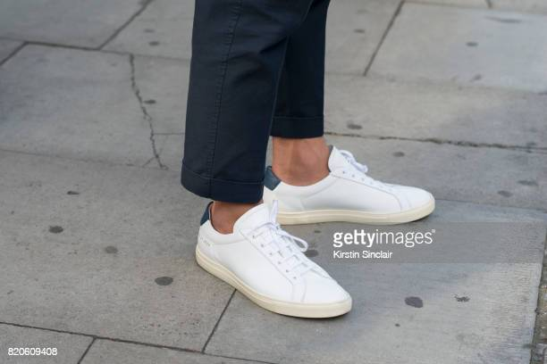 Fashion writer and blogger Jordan Bunker wears Common Project trainers and Initial Fashion trousers on day 3 of London Collections Men on June 11...