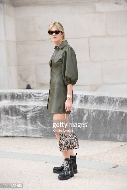 Fashion writer and digital influencer Camille Charriere wears a Ganni dress Paco Rabanne bag and Alexa Chung shoes on February 28 2019 in Paris France
