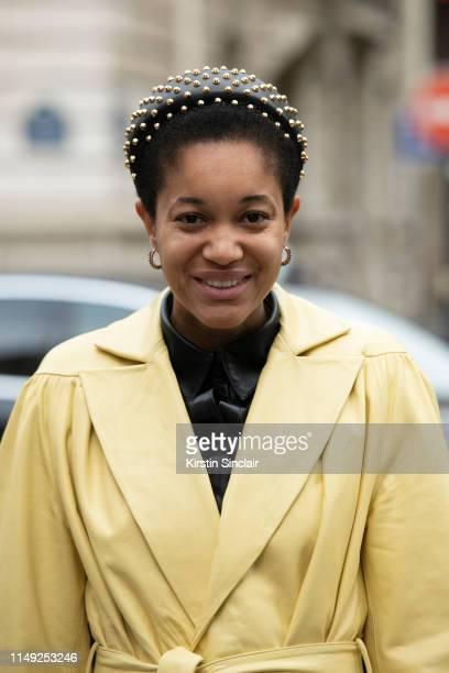 Fashion writer and digital influencer Tamu Mcpherson wears a Lesyanebo jacket Prada headband on March 02 2019 in Paris France