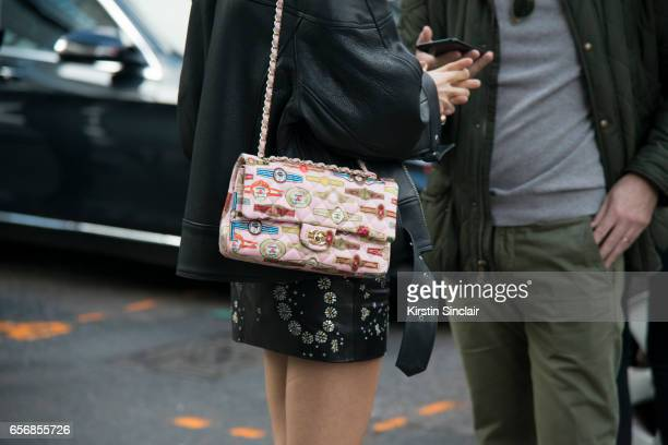 Fashion writer and founder of The Man Repeller Leandra Medine wears a Chanel bag on day 3 of London Womens Fashion Week Autumn/Winter 2017 on...