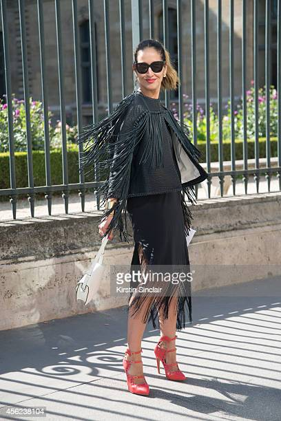 Fashion Writer and TV Presenter Tiany Kiriloff is wearing a Malene Birger jacket and dress Delvaux bag Aperlai shoes and Louis Vuitton sunglasses on...