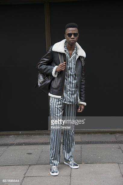 Fashion writer Collen Demerz wears a Zara jacket shoes and sunglasses French Connection bag and La Redoute top and trousers day 1 of London Mens...
