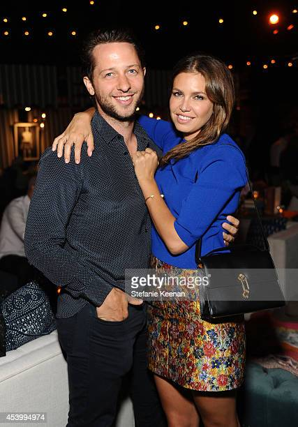 Fashion writer Derek Blasberg and Dasha Zhukova attend GENETIC x Liberty Ross Launch on August 22 2014 in Beverly Hills California