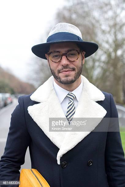 Fashion writer for I Officiel homme Kadu Dantas wearing Gant tie Zara  jacket and hat 60e6dac7363