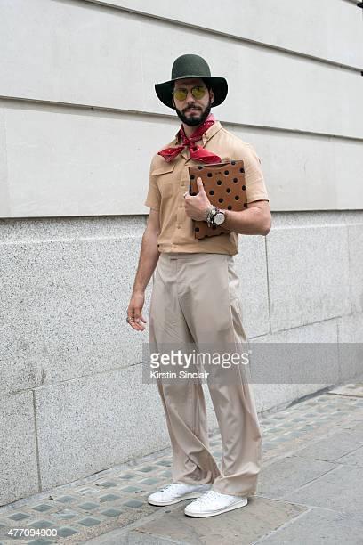 Fashion writer for I Officiel homme Kadu Dantas wears a Topman hat Gant  scarf Adidas 77f99c9f31b