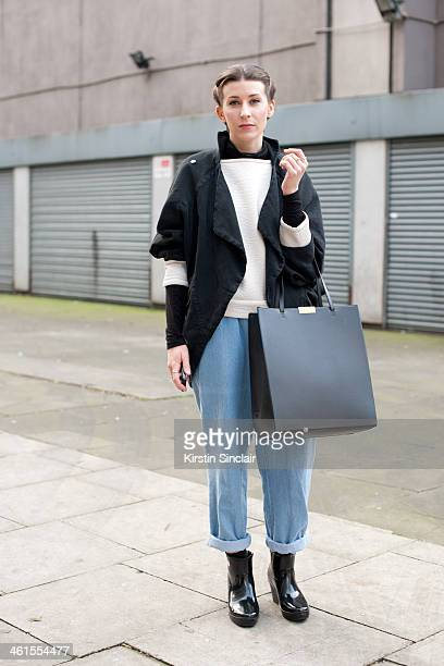 Fashion Writer for Who's Jack Anna Saunders wears a Bora Aksu coat vintage jeans Stella McCartney bag Zara top and Polo neck and Hunter boots day 3...