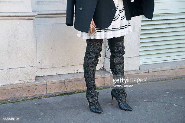 Fashion writer Nausheen Shah wears Bally jacket Alexandre Birman shoes on day 3 of Paris Collections Women on March 05 2015 in Paris France