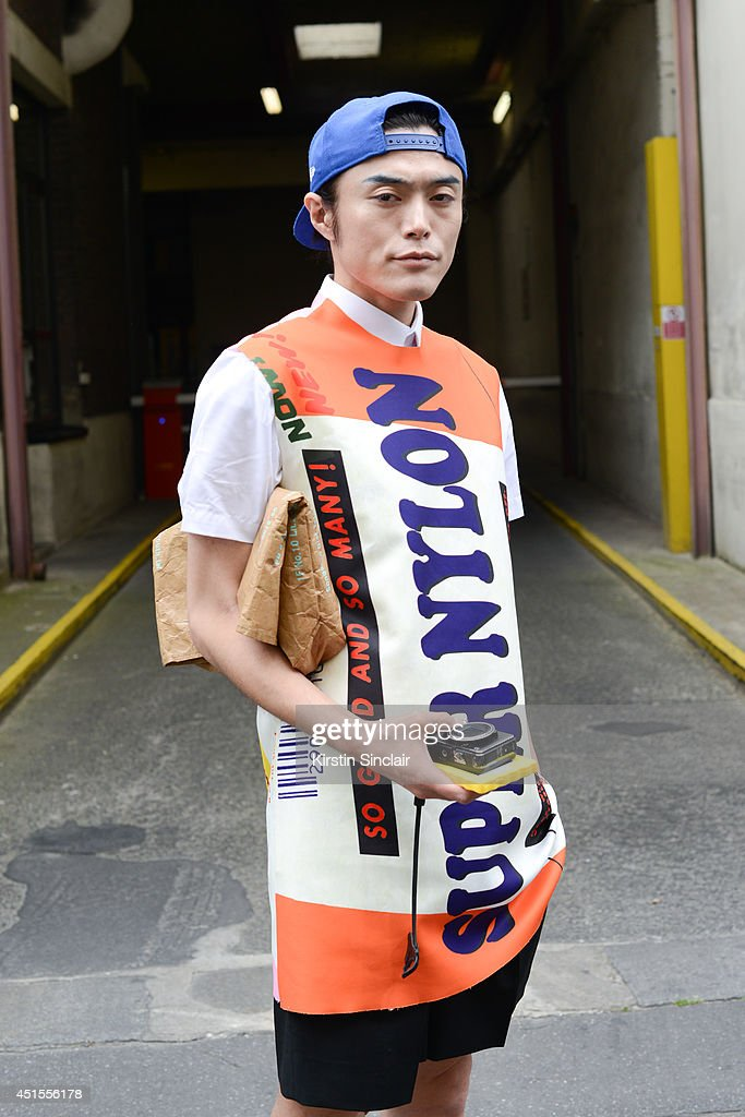 Fashion writer Yu Masui wearing Raf Simons top and shorts, New Era baseball cap and a United Arrows bag on day 1 of Paris Collections: Men on June 25, 2014 in Paris, France.