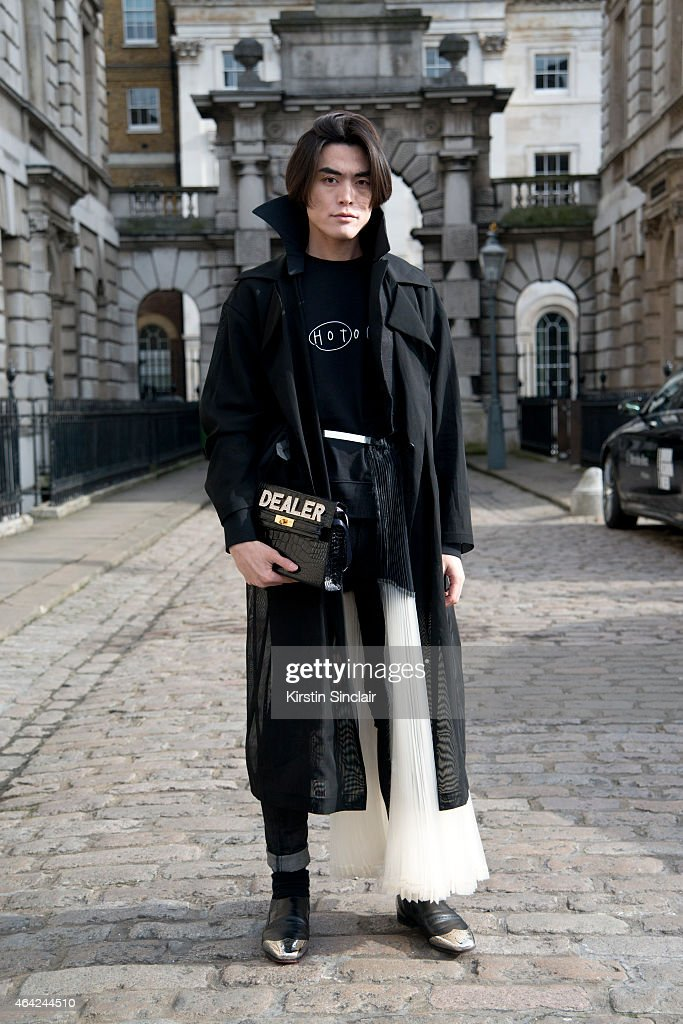 Fashion writer Yu Masui wears an Acne sweatshirt, Mawi bag, Cheap Monday jeans, Toga belt and Christian Louboutin boots on day 3 of London Collections: Women on February 22, 2015 in London, England.