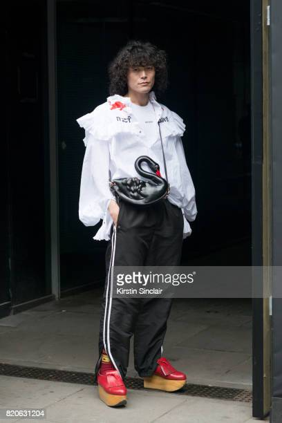 Fashion Writer Yu Masui wears Vivienne Westwood shoes Lonsdale trousers Dry Clean only top Yang Du bag and a band of Outsiders T shirt on day 3 of...