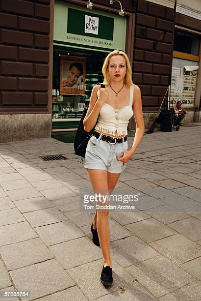 Fashionable 17 year old Arijana Kaljanac window shops on a Sarajevo high street as the city begins to come to life again after four years of siege...