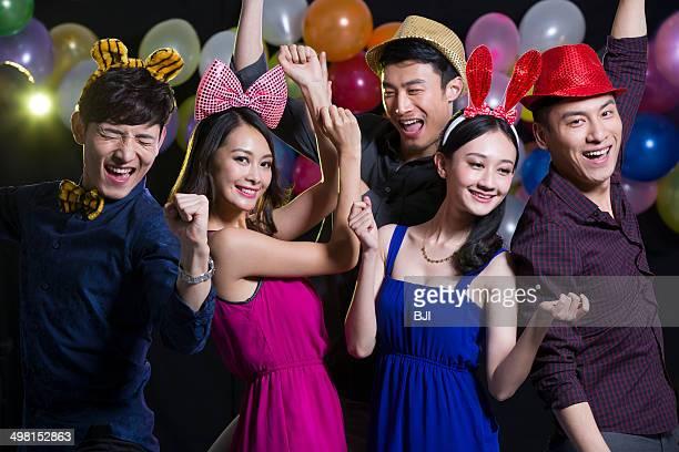 Fashionable adults dancing