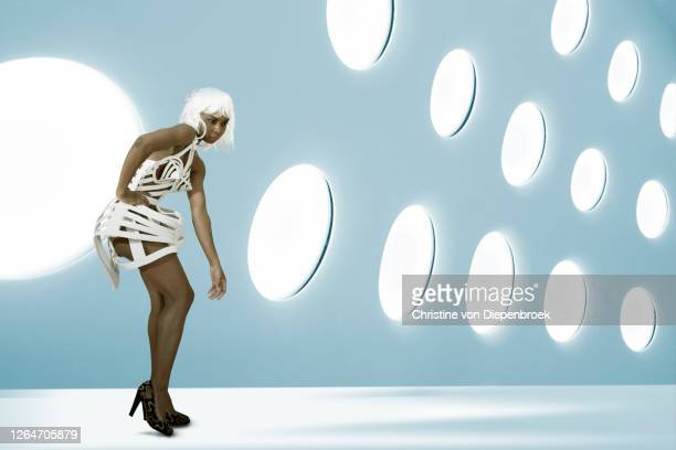 fashionable african woman in modern surrounding - fashion show stock pictures, royalty-free photos & images