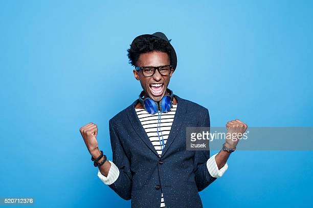 fashionable afro american guy expressing happiness - attitude stock pictures, royalty-free photos & images