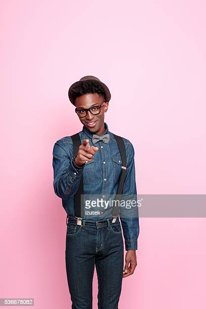 Fashionable afro american guy pointing with index finger